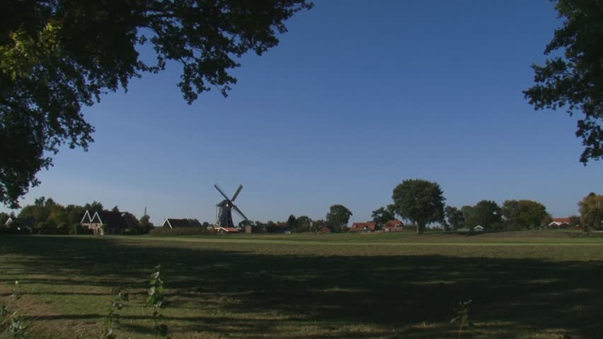 THE NETHERLANDS - OCT: windmill Bataaf anno 1801 in dutch rural landscape turning wicks or sails front  - wide shot - HD stock footage clip