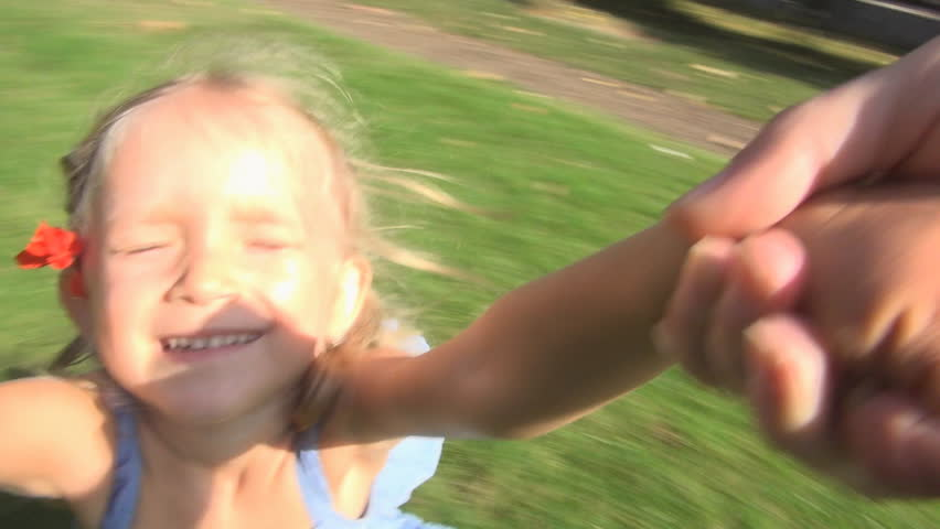 Children Playing in Park, Mother Spinning her Little Girl, Kid Smiling at Camera, POV