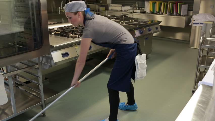 Cleaner cleaning the kitchen and wiping the floor with a mop - HD stock video clip