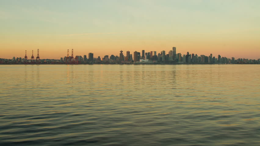 Skyline of City of Vancouver, BC, Canada. Morning Sunlight reflecting from the buildings in downtown, Slowly lighten up the city of Vancouver. Shot in 4k RAW photo sequence