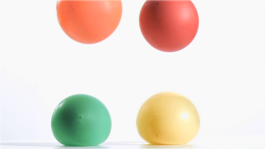 Balloons falling in super slow against white background