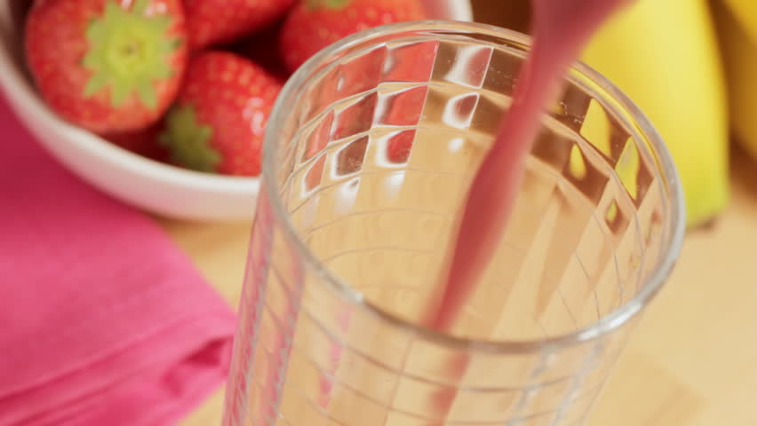 Pouring fruit smoothie overhead - HD stock footage clip