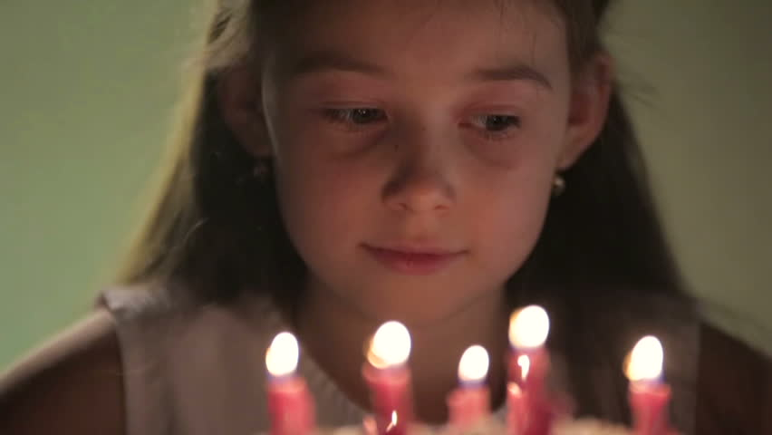 Birthday girl and cake with candles - HD stock footage clip