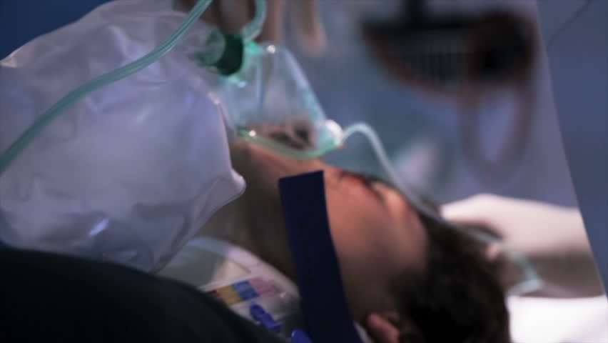 Medical crew removes ventilation mask of the dead patient - HD stock footage clip