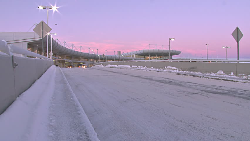 ANCHORAGE, AK - CIRCA 2012: Early morning outside the passenger entrance of Ted Stevens International Airport ( ANC ) on a cold winter's morning in Anchorage, Alaska. - HD stock video clip