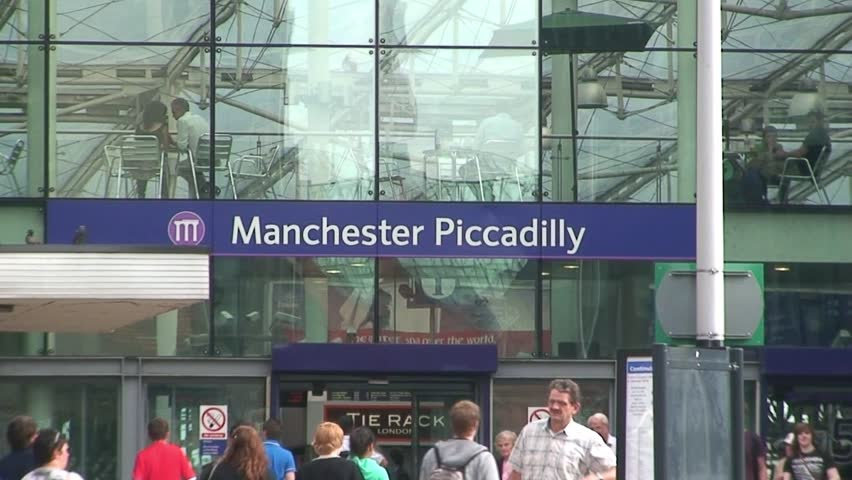 MANCHESTER, ENGLAND - CIRCA 2011: Bus passes front of Manchester Piccadilly Railway Station