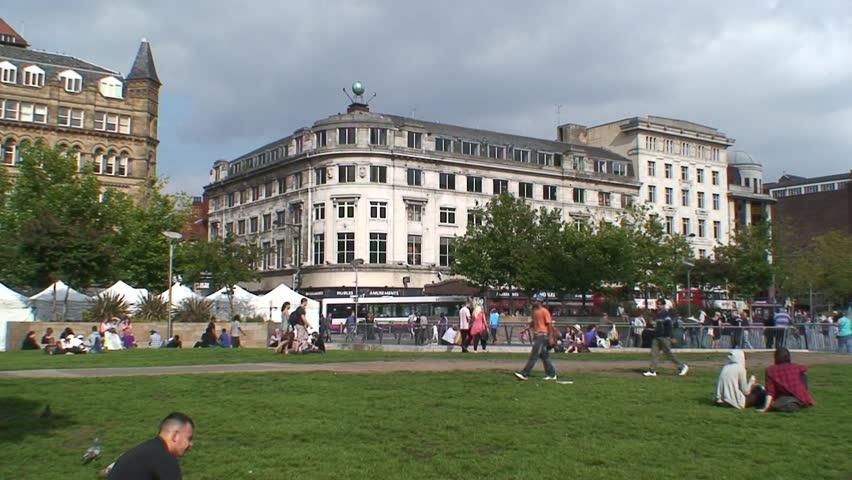 MANCHESTER, ENGLAND - CIRCA 2011: A busy Piccadilly Gardens in Manchester City Center.