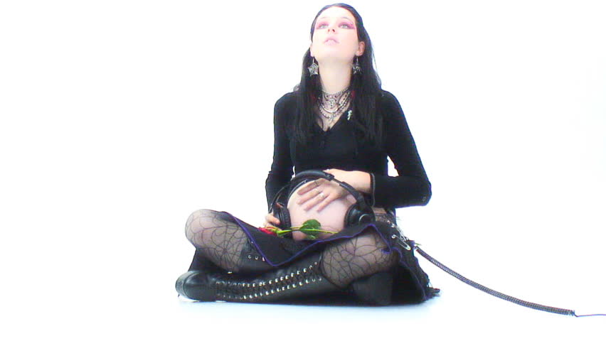 "Pregnant ""Goth"" girl sits - listening to headphones - HD stock footage clip"