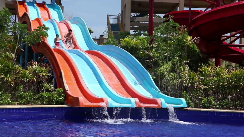 boy and girl on water slides