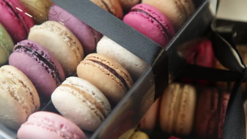 pan over colorful macaroons in a box