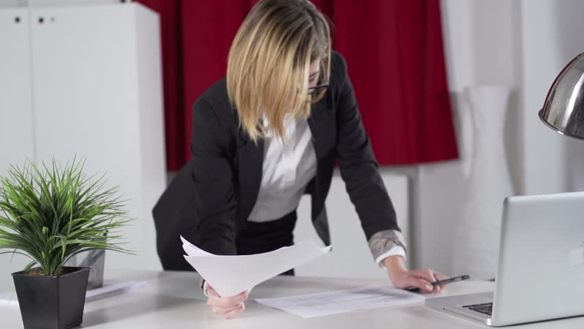 Slow Motion Dolly Shot Of Young Business Woman Throwing Documents At Camera