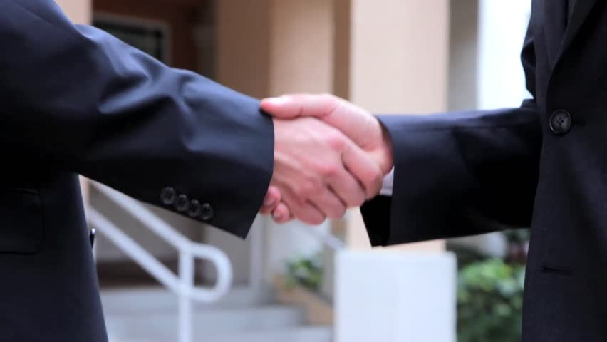 Handshake - Businessmen shaking hands business deal partnership high definition. CloseUp - HD stock footage clip