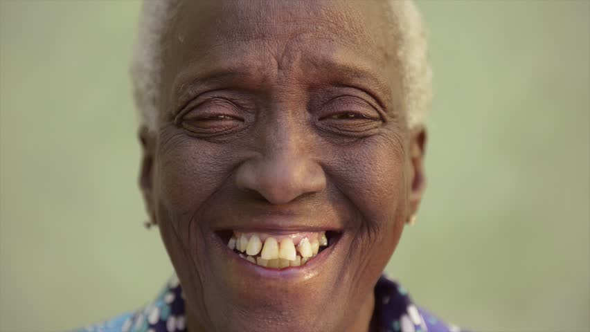 Old people and emotions, portrait of bizarre senior african american lady laughing and looking at camera - HD stock video clip