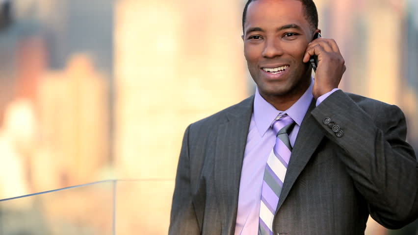 African American male business manager on a cell phone on rooftop overlooking NYC | Shutterstock HD Video #3290351