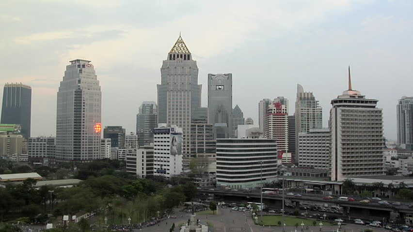 Skyline of Buildings in Silom and Sathon District with Lumphini Park Timelapse Day-to-Night | Shutterstock HD Video #3309251