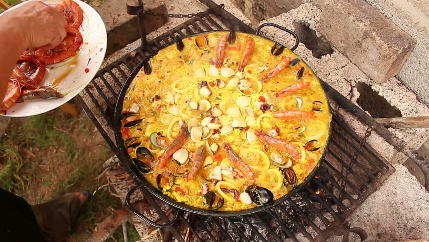 Seafood paella in the fry pan, typical Spanish dish (paella de marisco)