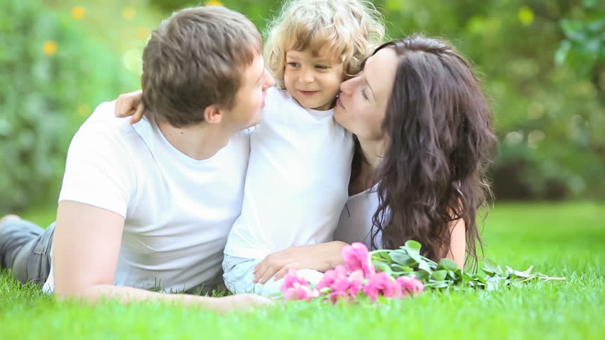 Happy family having fun outdoors in spring park  | Shutterstock HD Video #3329114