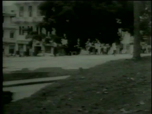 Soldiers throw smoke bombs at protesting panamanian students in the Canal Zone Panama circa 1964-MGM PICTURES, UNIVERSAL-INTERNATIONAL NEWSREEL, USA, filmed in 1964   - SD stock video clip