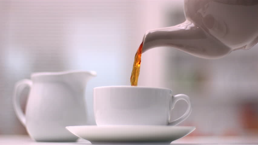 Teapot Pouring Tea In Slow Motion Stock Footage Video ...