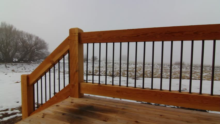 A jib shot of a foggy winter morning from a deck of a house | Shutterstock HD Video #3356465