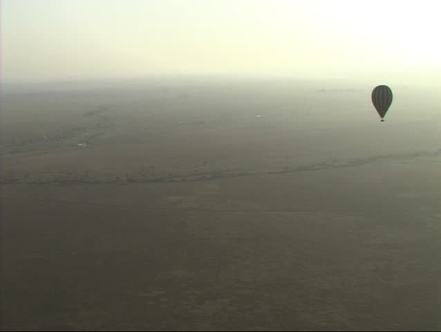 Hot air balloon flying over Serengeti NP - SD stock footage clip