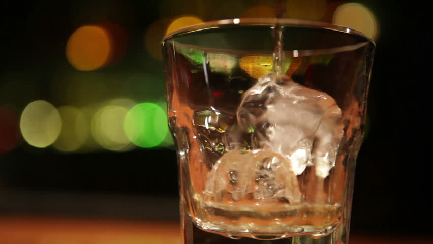Tracking shot of serving whiskey - HD stock video clip