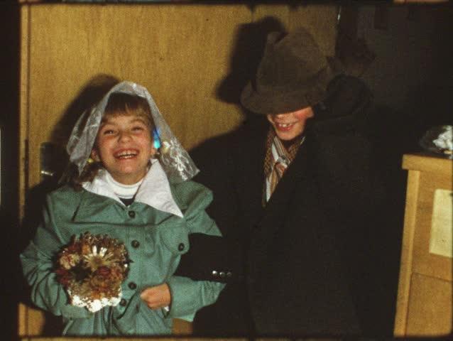 Vintage 8 mm film: Children play wedding - HD stock footage clip