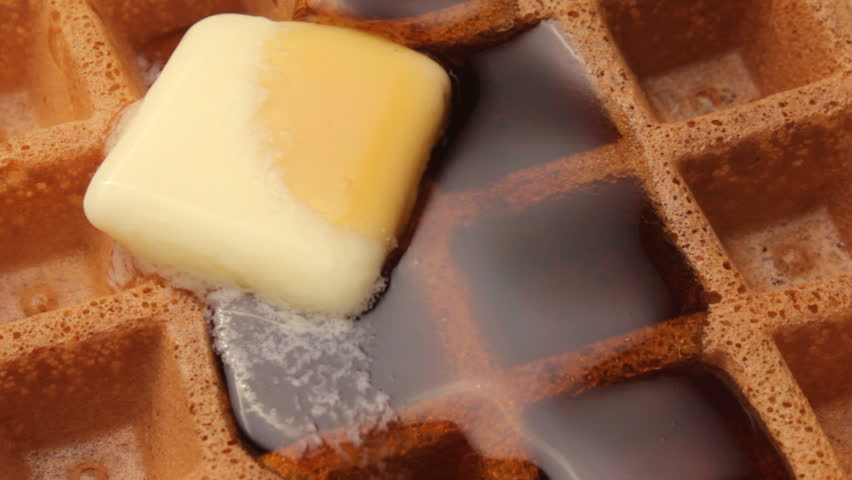 Maple syrup, butter and waffle
