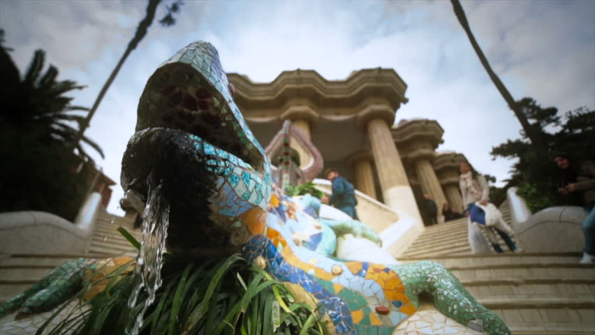 SPAIN, BARCELONA - CIRCA JANUARY 2013 Fountain of a salamander made of colorful mosaics in the Parc Güell.