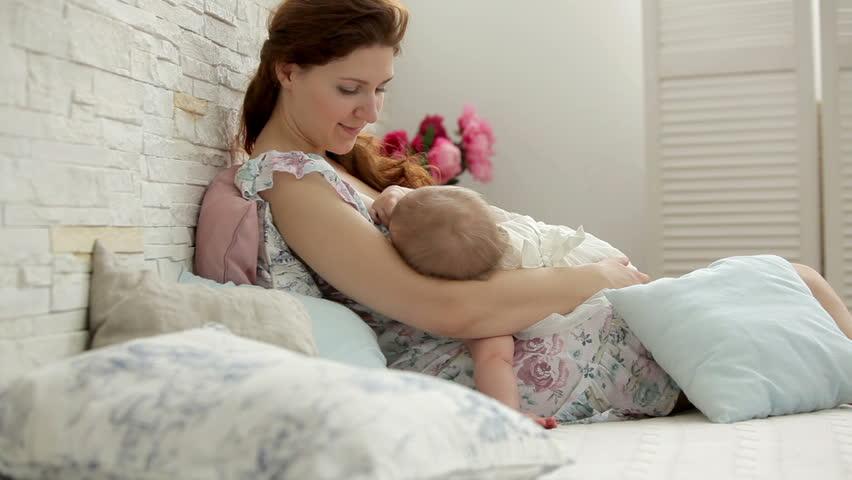 Mother breastfeeding a baby girl