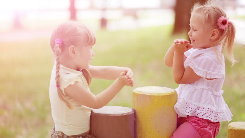 Sunny girls outdoors.Children playing in the Kids Count. Slow motion - HD stock footage clip