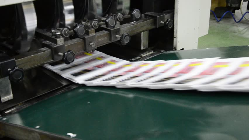 finished brochure magazine goes on the packaging line after it is printed on the