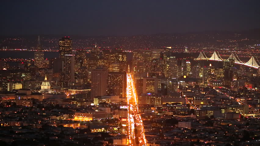 San Francisco downtown skyline 24p at night tilt down