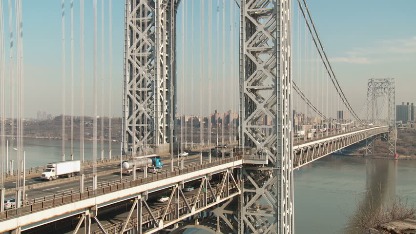 NEW YORK - FEBRUARY 13: Afternoon traffic flows over the George Washington Bridge high over the Hudson River between New York and Fort Lee, New Jersey on February 13, 2013 in New York. - HD stock footage clip