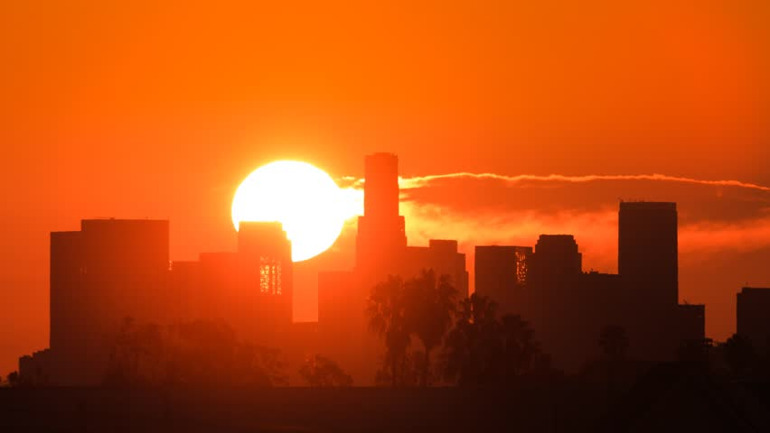 Sunrise over Los Angeles skyline. Zoom-in on downtown. Timelapse.