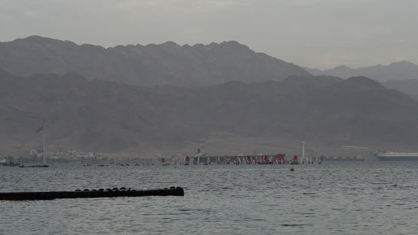Time Lapse. People participate in water sport activities at the Gulf of Aqaba (Red Sea) near Eilat, Israel - HD stock video clip