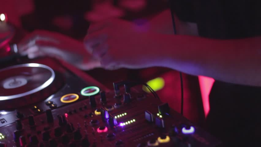 Dj's hands during the party in night club
