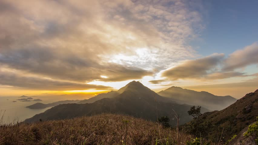 Time Lapse of Cloudy Sunset at Lantau Peak in Hong Kong. Photo Sequence shot on DSLR camera and Post-Production in After Effects