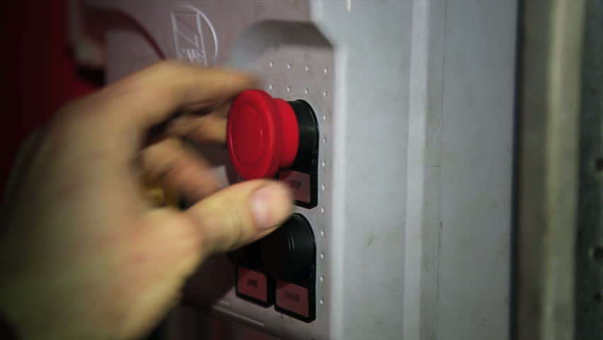 Man pushing green and red buttons in a workshop - HD stock footage clip