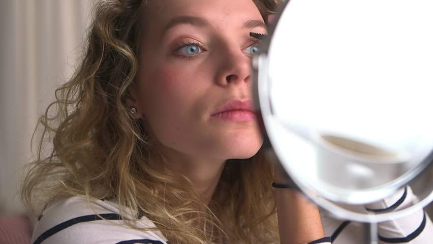Caucasian woman putting on mascara | Shutterstock HD Video #3441803
