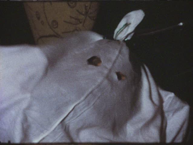 Vintage 8mm film: Girl under sheet, disguised as ghost, 1970s