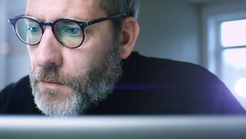 Close up of a businessman working concentrated with his computer - tracking shot | Shutterstock HD Video #3450101