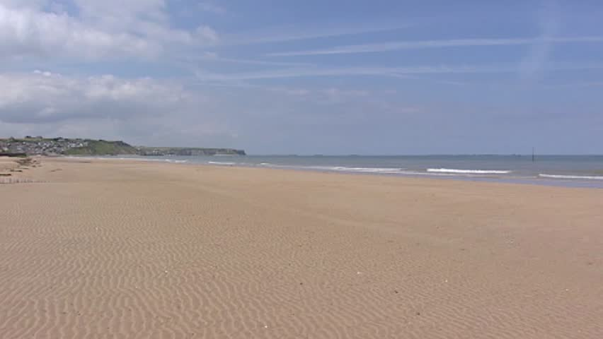 Arromanches, D-Day Gold Beach + pan bay with Mulberry Harbour at horizon. Gold Beach was the code name of one of the D-Day landing beaches - HD stock video clip