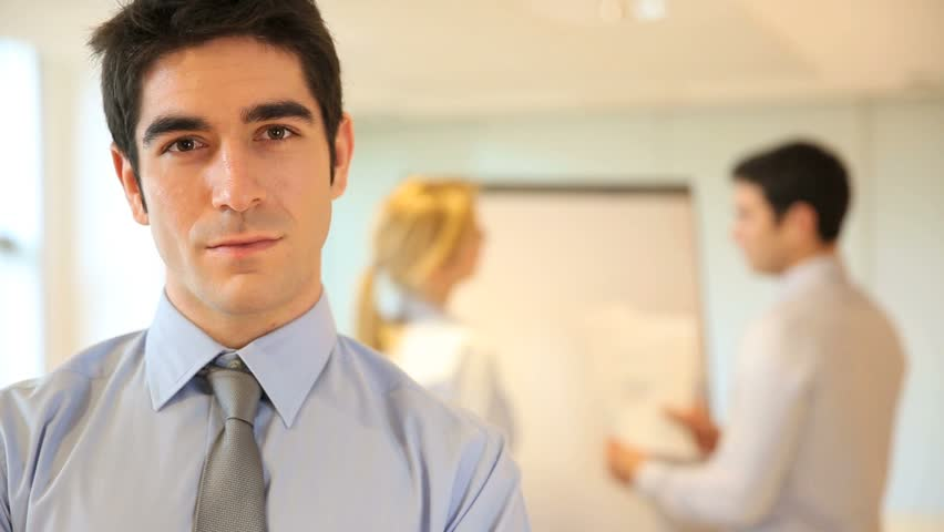 Young businessman presenting company business