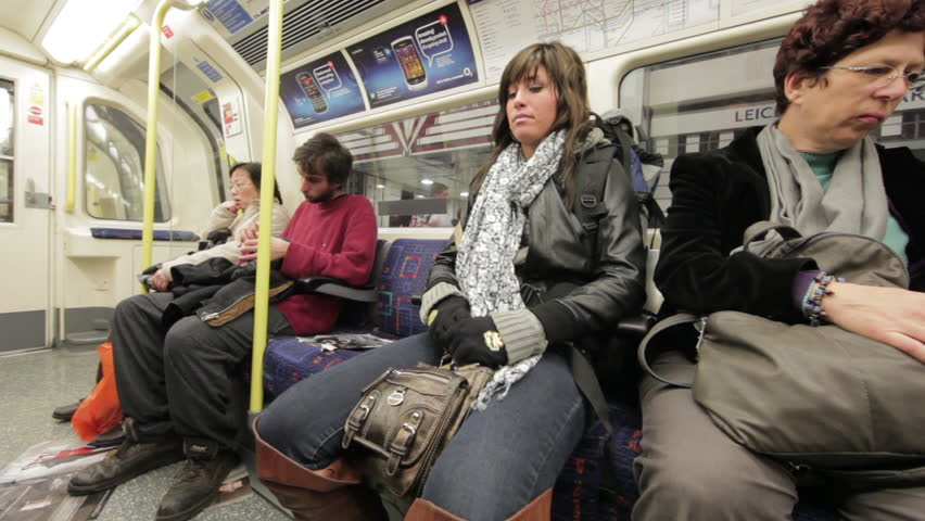 LONDON - OCTOBER 8: Unidentified people sit in train carriage on Oct 12, 2012. - HD stock footage clip
