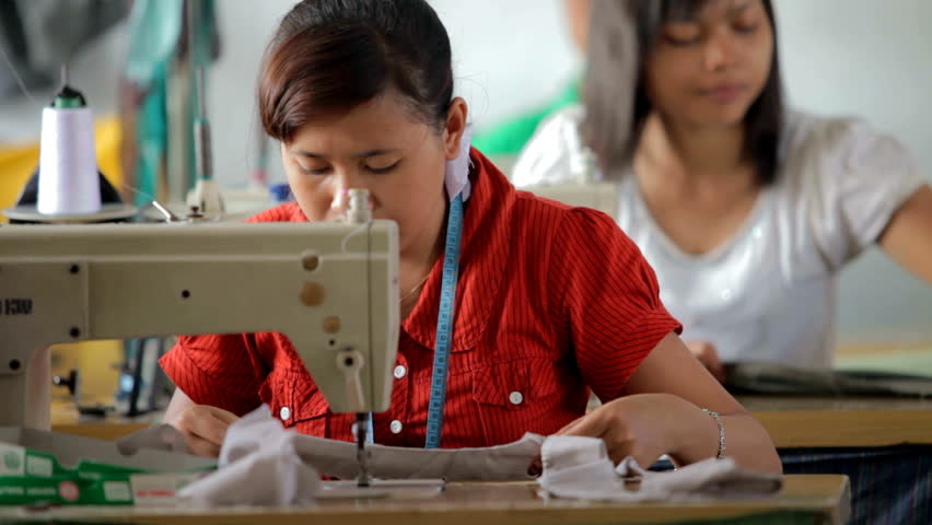 BALI - MARCH 5. Women stitching in small workshop on March 5, 2012 in Bali, Indonesia. Since entering the CAFTA (asian free trade agreement) Bali has difficulties competing with China.
