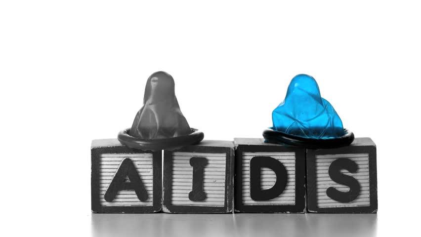 Condoms falling on blocks spelling AIDS in slow motion - HD stock footage clip