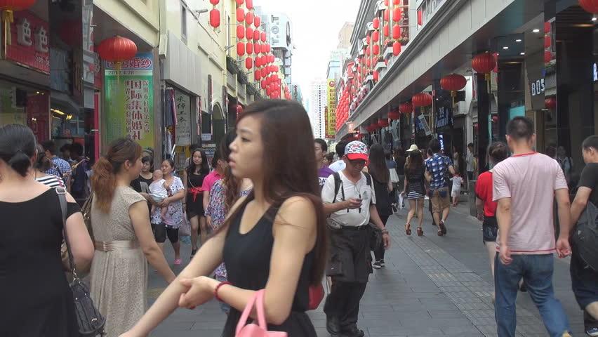 SHENZHEN, CHINA - MAY 5, 2012, Tourists visit Shopping District
