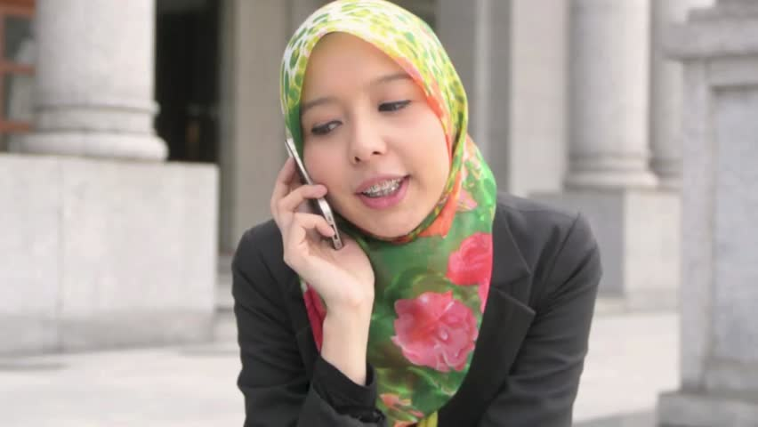 Scarf girl with braces teeth use cellphone  - HD stock footage clip