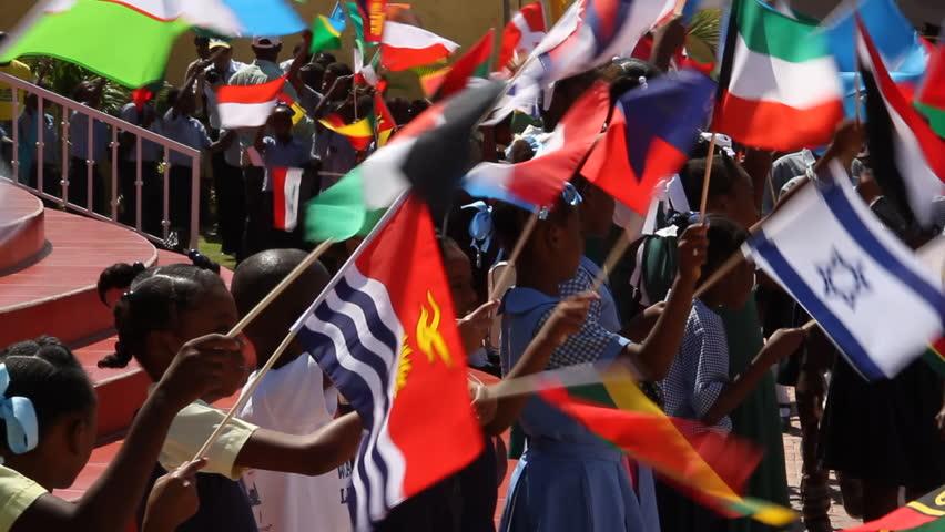 PORT AU PRINCE, HAITI  - CIRCA MAY 2012: Haitian children wave international flags | Shutterstock HD Video #3533720
